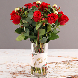 send a dozen of red roses with xmas ornaments to philippines